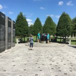 """A floating marble world atop 1/8"""" of water resides in middle of WWII memorial here."""