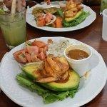 "Shrimp stuffed avocado, rice and beans, ""ensalada chilena"" and Mojito"