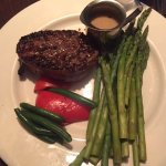 Filet mignon with whiskey peppercorn sauce and a side of asparagus