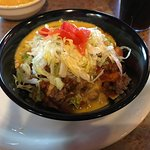 Frito pie with red chile, queso, and lettuce and tomatoes.  Also had the carnitas burrito with r