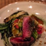 Pan-seared elk with grilled Romaine, shaved fennel and heirloom tomatoes