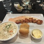 Top plate: scallops wrapped with bacon, Bottom: chowder with dinner roll and butter