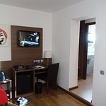 TV and desk in room