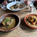 Lamb tagine, couscous, and roasted lamb with poached egg