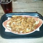 Poutine and beer at Kelsey's Original Roadhouse