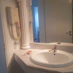 Bathroom of Room 265 - hair dryer on wall
