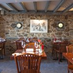 Beamed ceilings and stone walls create a warm ambience.