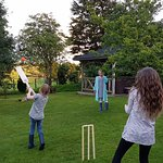 Having fun playing cricket in the garden.