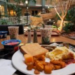 Breakfast near the indoor garden fountain.