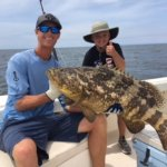 A goliath grouper that weighed more than the angler who caught him!