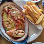 Lobster in garlic butter sauce with chips