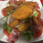 lightly crusted Reblochon cheese on top of greens, vegetables and sliced meats!