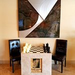 Enjoy a relaxing game of chess on our custom chess board!