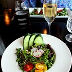 A beautifully arranged green salad.