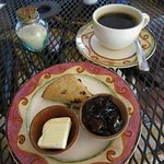 Currant Scone with butter and marmalade, organic coffee