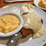 Country fried steak, gravy, eggs, cheese grits, and a cheese biscuit.