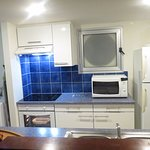 Kitchen & has washing machine on the left