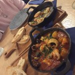 Garlic prawns and mixed seafood in red wine sauce