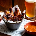 Something light and tasty? Hot smoked wings, tossed in brew-BBQ sauce, amasi-ranch and beeracha!