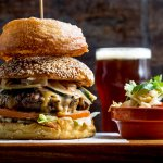 Pure bliss is a Beerhouse Burger! Coarse ground pure beef, beer-cheese and brew pickles.
