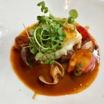 Cod bouillabaisse with side of salad and potato