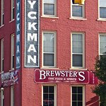 At the stoplight in the center of town, in the old Dykman Hotel