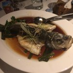 steamed seabass with ginger and scallion in solo sauce before deboned and Lotus leaf rice
