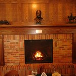 Dining room fireplace with Teddy Roosevelt bust.