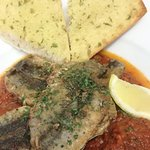 Sardine fillets with our tomatoes and red pepper sauce. Yummy.