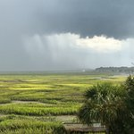 View from our room of a thunderstorm over the marsh