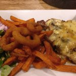 Steak with stilton and mushroom topping.