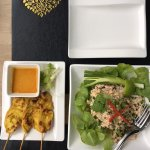 Chicken satay skewers and chicken larb salad