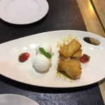 Fried bananas role and coconut ice cream