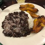 beans, rice, fried plantains, garlic butter for the plantain chips in the background