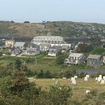The view of Monhegan Village from the lighthouse. The Island Inn is in the center.