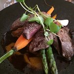 Filet of lamb green asparagus,Port sauce and coconut dressing