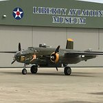 Vintage WWII Warbird heading out to an air show.