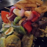 kebabs with scallops, shrimp, steak, peppers, onions over yellow rice; grilled veggies, onion ri