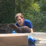Baby otter and trainer