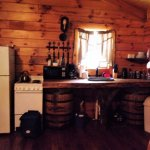 The full kitchen area of whiskey cabin/front door at the right.