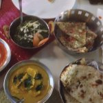 Our food (butter chicken curry, naan, palak paneer)