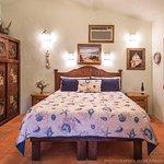 Casita 3 king bed, large closet area, room safe, alarm clock, TV/VHS/DVD combo.