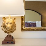 Custom accents include tiger lamps, headboards resembling the hotel logo, and tiger striped shea