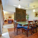 The dining room in an Aalia Villa with the living room behind it