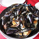 Mussels in wine and cream sauce. Other choices of sauces are available
