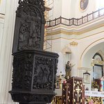 The intricate carvings on the podium