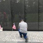 my husband after leaving his vietnam book at the wall