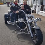 My inlaws and wife, posing on the trike.