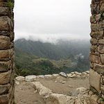 Through this gap, one can vaguely see Machu Picchu