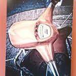 Picture on the wall - headlight and handlebars (Vespa??)
